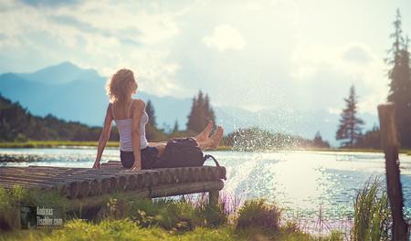Urlaub in Österreich, Frau beim Entspannen, Relaxen, Bergsee, Wandern - Urlaub in Österreich, Frau beim Entspannen, Relaxen, Bergsee, W by Andreas Tischler